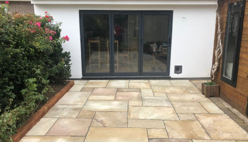 Indian Sandstone Patio with Treated Sleepers in Bristol